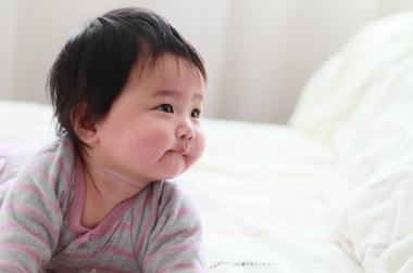 Cute infant looking upwards