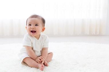 Infant grinning
