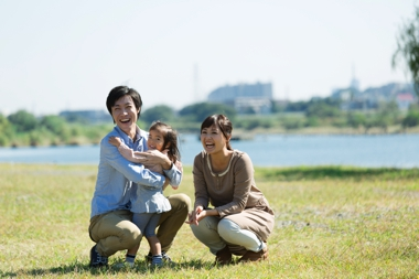 Family having fun outdoors in the sun