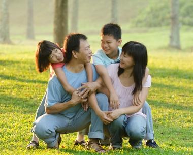 Harmonious happy family having fun in the outdoors